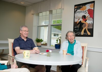 Independent living residents talking over a meal at Scott-Farrar in Peterborough