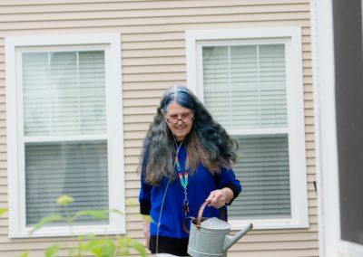 Scott-Farrar senior living residents watering the garden
